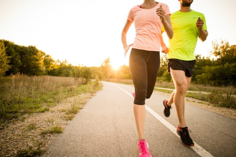Two people jogging at sunrise