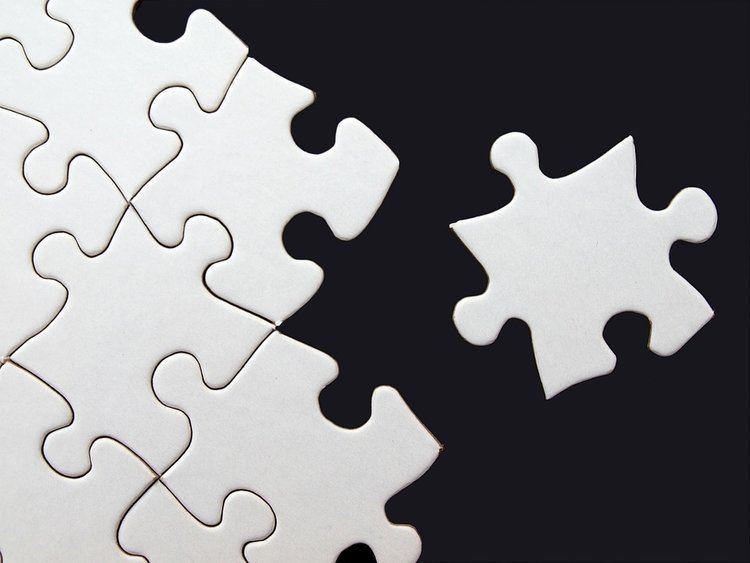 black and white puzzle pieces