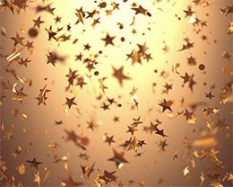 star confetti falling on a gold background