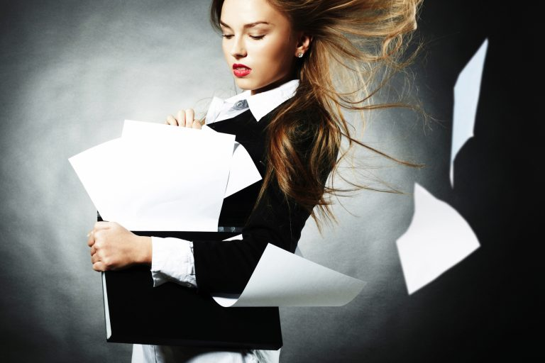 A woman with papers flying