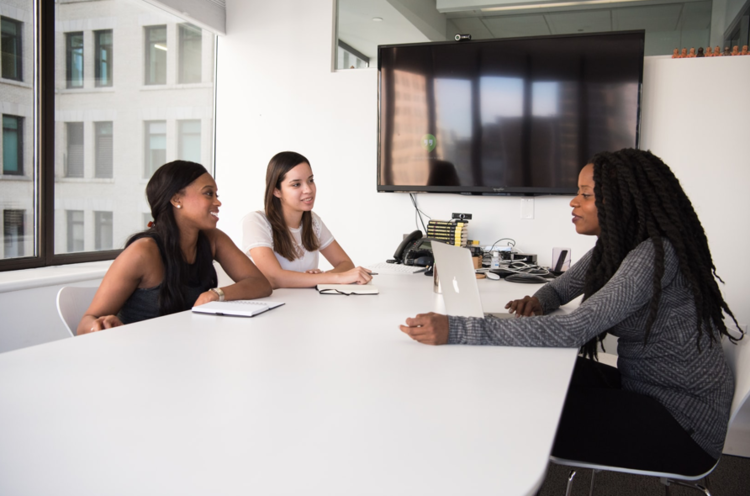 women sitting at office table